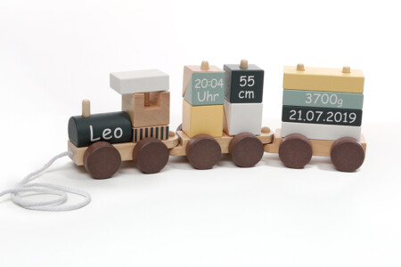 Wooden pull toy train with wooden cubes